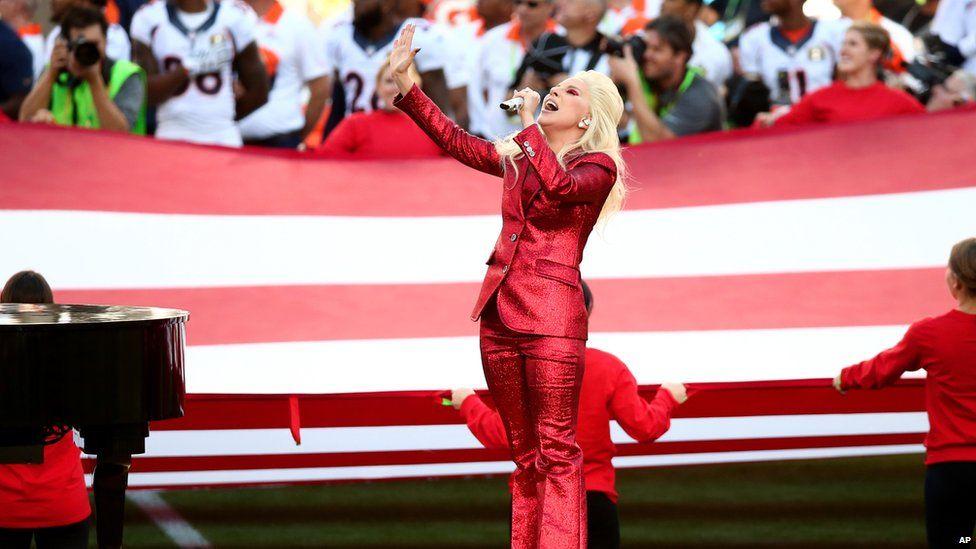 Lady Gaga performing at the 2016 Super Bowl.