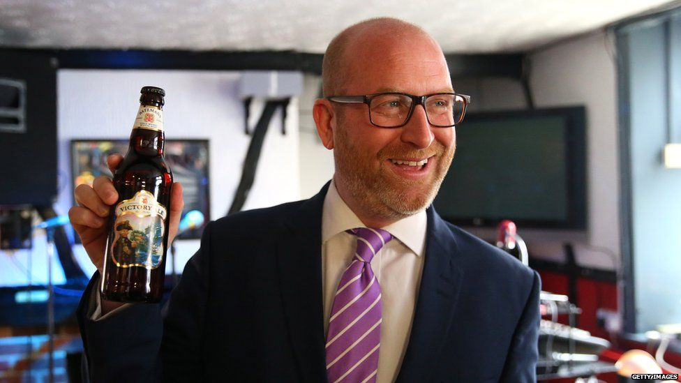 Paul Nuttall with a bottle of beer