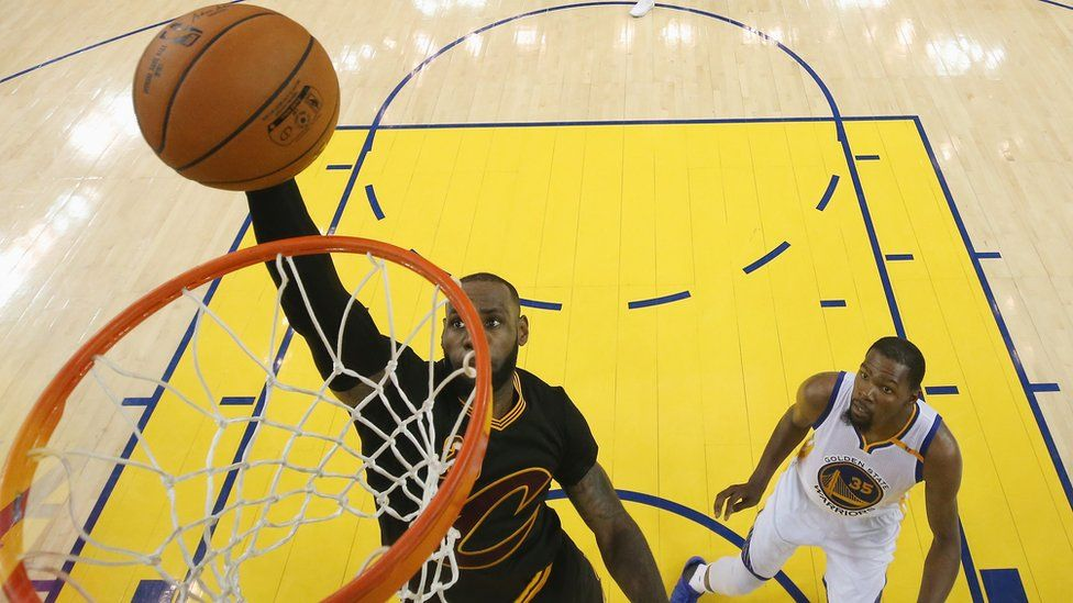 LeBron James #23 of the Cleveland Cavaliers dunks the ball ahead of Kevin Durant #35 of the Golden State Warriors in Game 5 of the 2017 NBA Finals at ORACLE Arena on June 12, 2017 in Oakland, California