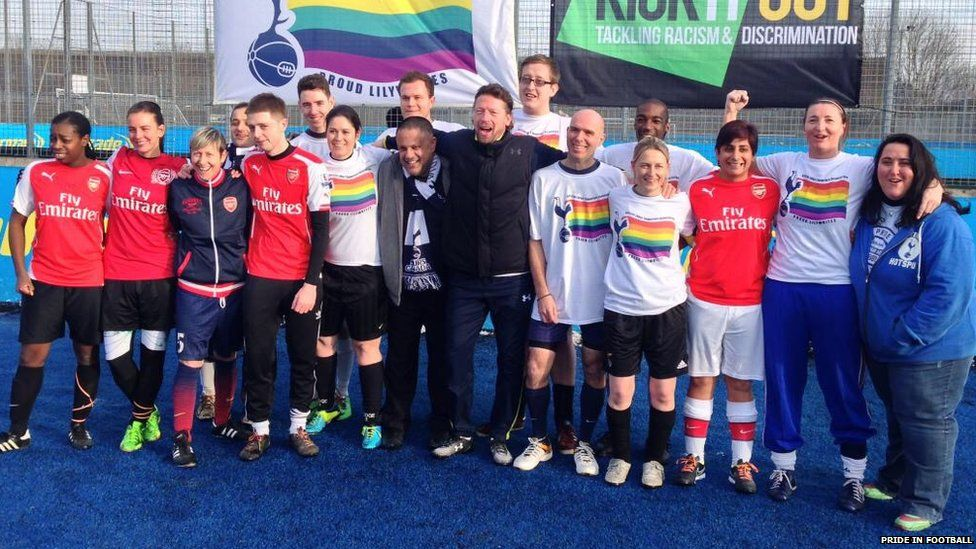 Chris Paouros poses with members of the Proud Lilywhites and Gay Gooners