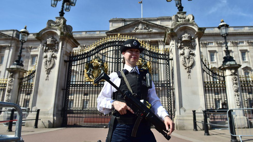 Armed police at Buckingham Palace