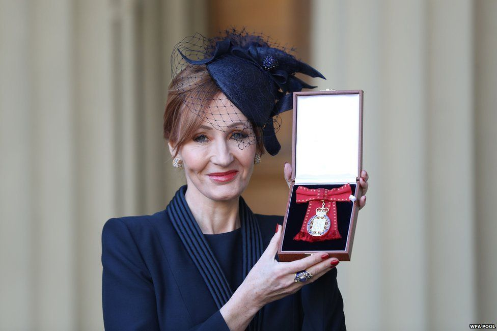 J. K. Rowling posing with her Companion of Honour medal, which she won this week.