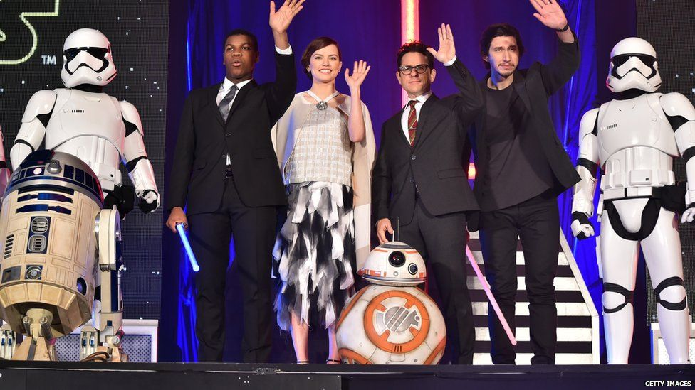 R2D2, stormtroopers, BB8 and the Star Wars new cast for The Force Awakens all waving goodbye