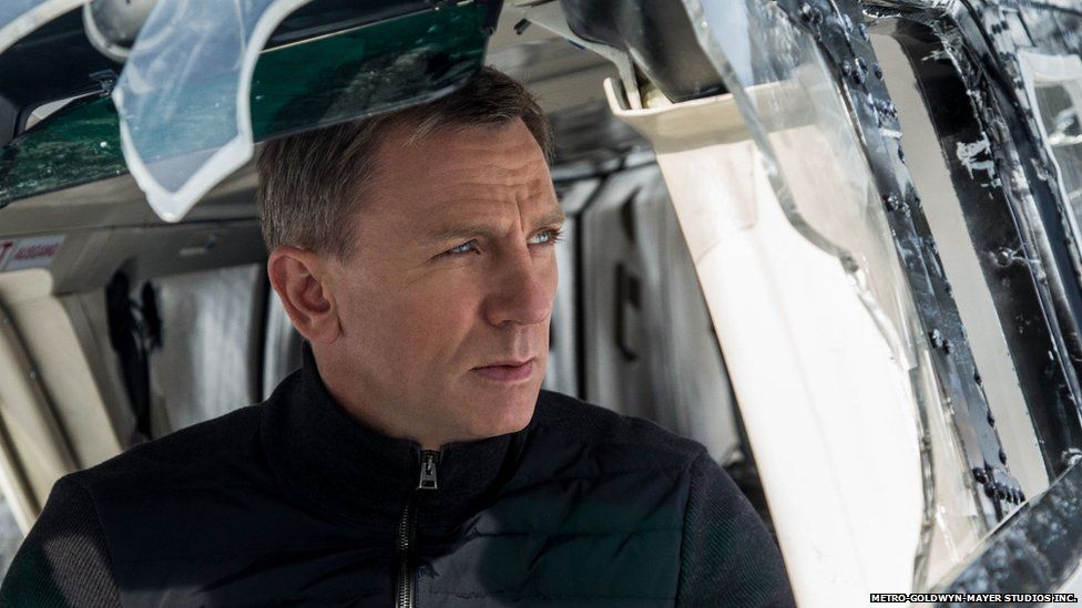 Daniel Craig as James Bond in a scene involving a helicopter crash from the latest film in the franchise, Spectre