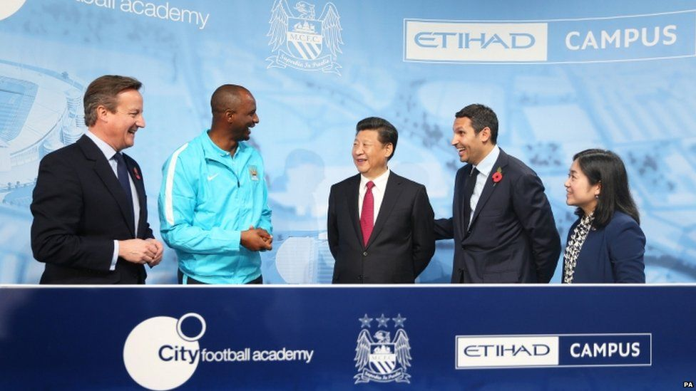 Head coach Patrick Vieira, Chinese President Xi Jinping and Manchester City Chairman Khaldoon Al Mubarack during a visit to the City Football Academy in Manchester