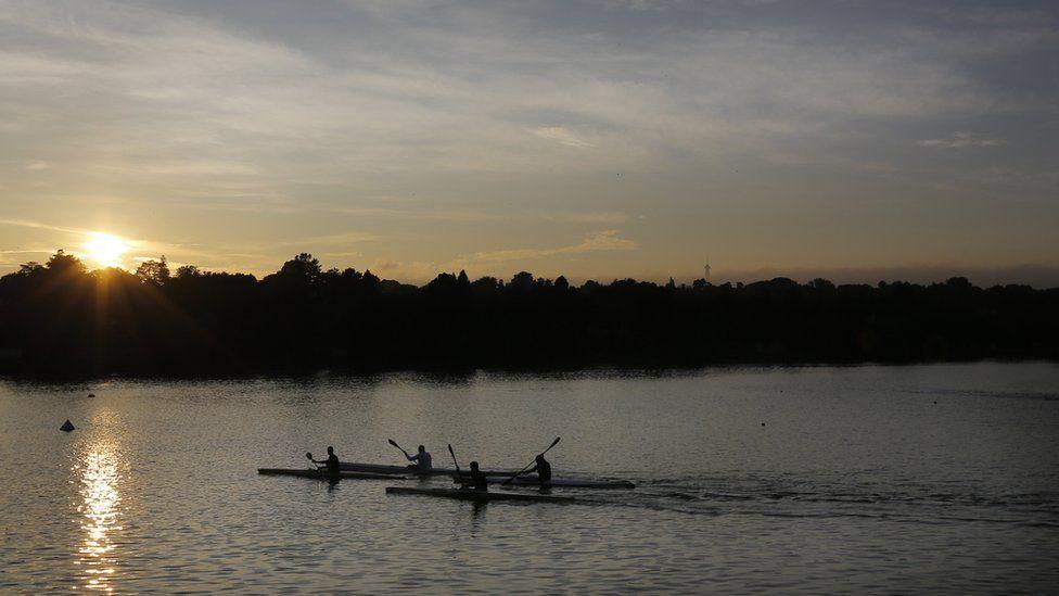 Canoeists training on Emmarentia Dam at sunrise near Johannesburg, South Africa - Thursday 9 February 2017