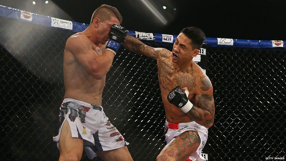 Michael Badato punches Jason Scerri during the Cage Muay Thai 8 bout