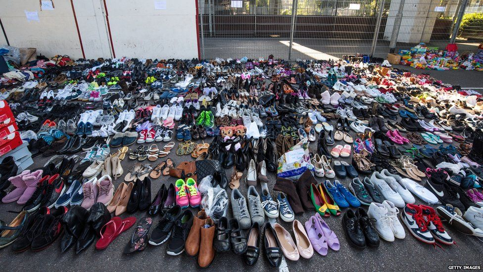 Donated shoes sit in the Westway Sports Centre near to the site of the Grenfell Tower fire