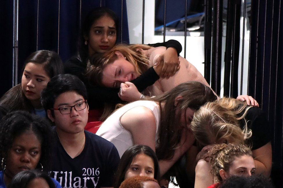 A group of women react as voting results come