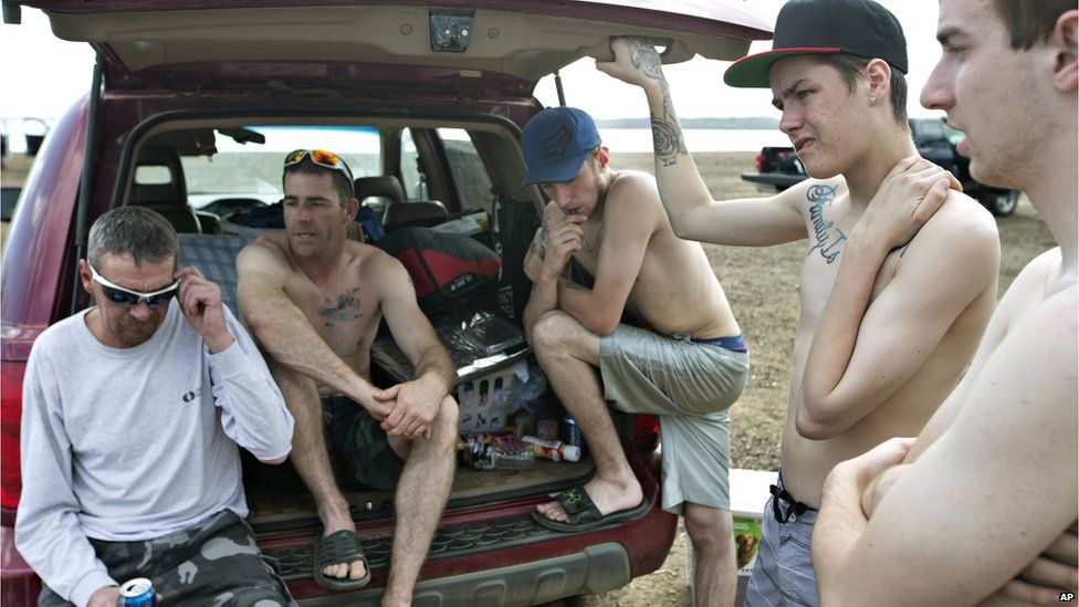 Topless and homeless they spent the night in their van after being evacuated from their homes in Alberta, Canada.