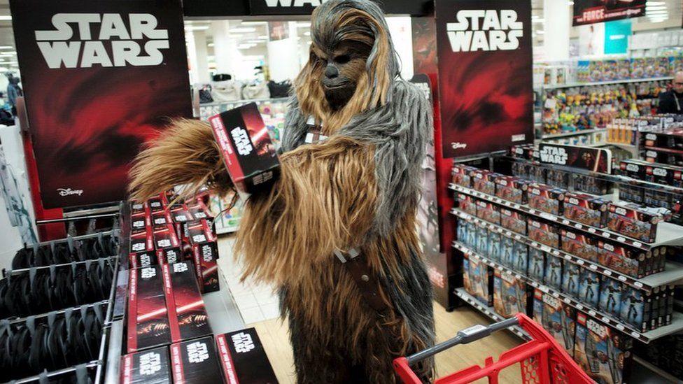 Fan dressed as Chewbacca shops
