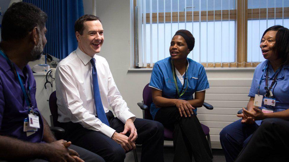 Chancellor George Osborne with healthcare staff.