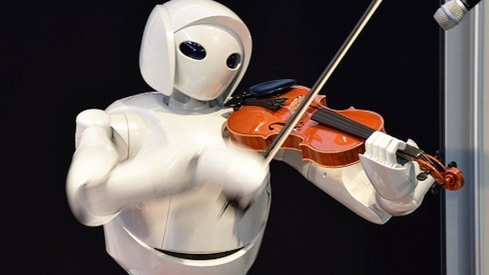 Toyota's violin-playing robot plays at Universal Design Showcase on December 6,2007 in Tokyo, Japan. The robot, which has 17 joints in both arms, uses precise control to play the violin. Toyota aims to develop robot technology to assist nursing and medical care by the year 2010