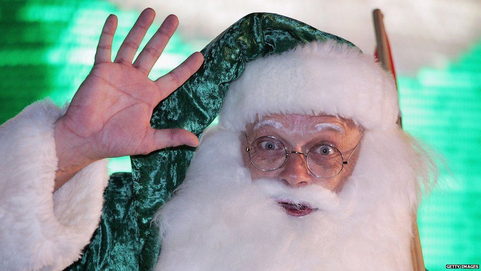 This is a photo of Santa Claus dressed in a green costume in the united Kingdom.