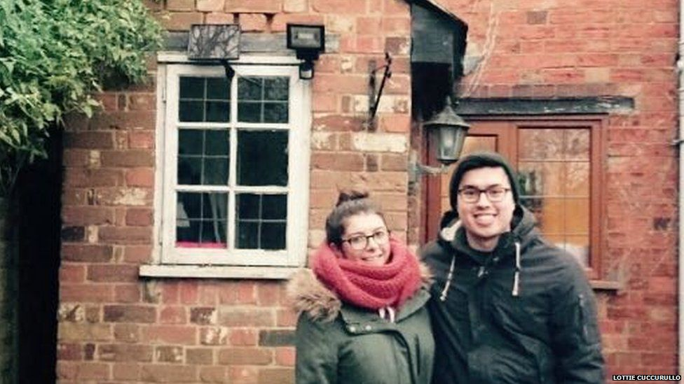 Lottie with her boyfriend in front of their house