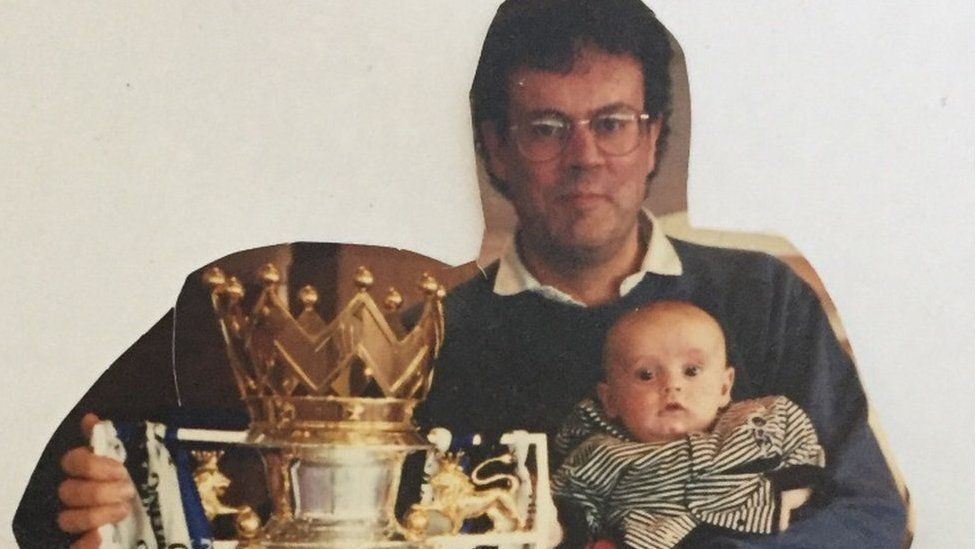 Paddy at two months old with the Premier League trophy.