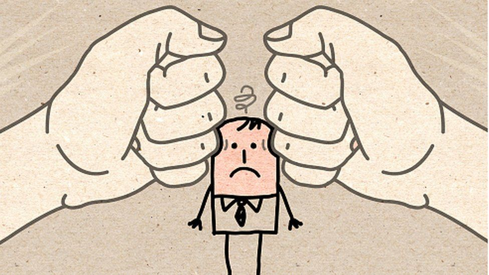 Cartoon picture showing person with a migraine