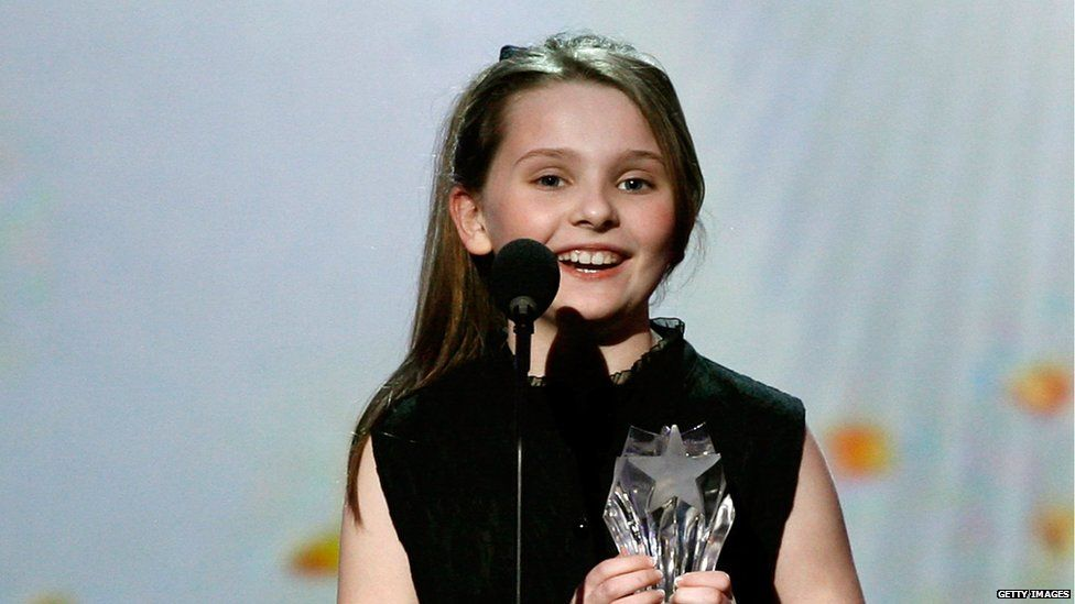 Abigail Breslin as a child at an awards ceremony