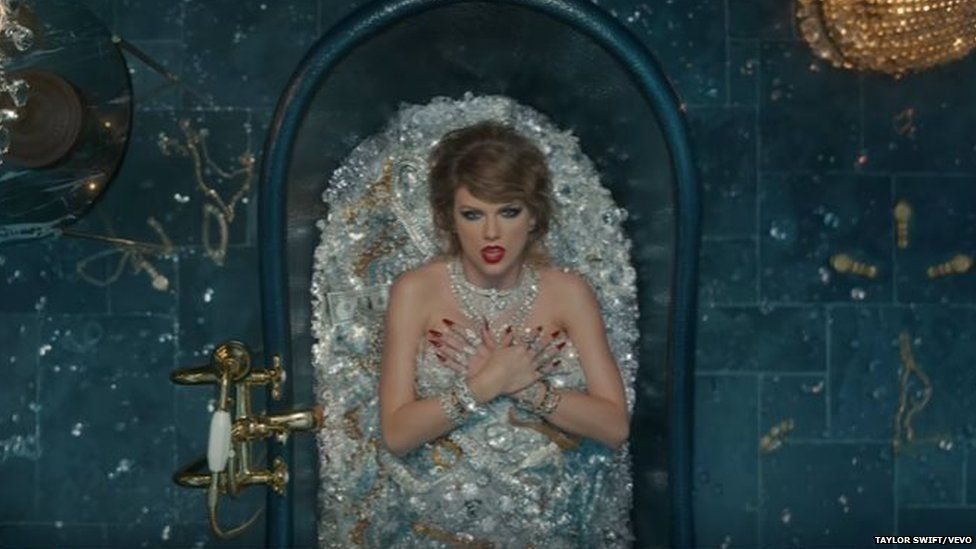 Taylor Swift in a bath of jewels
