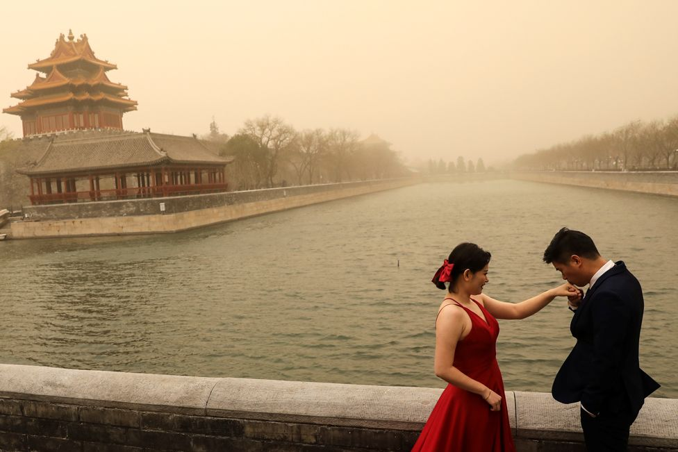 A couple during a wedding photoshoot near the Forbidden City, Beijing, on 15 March 2021