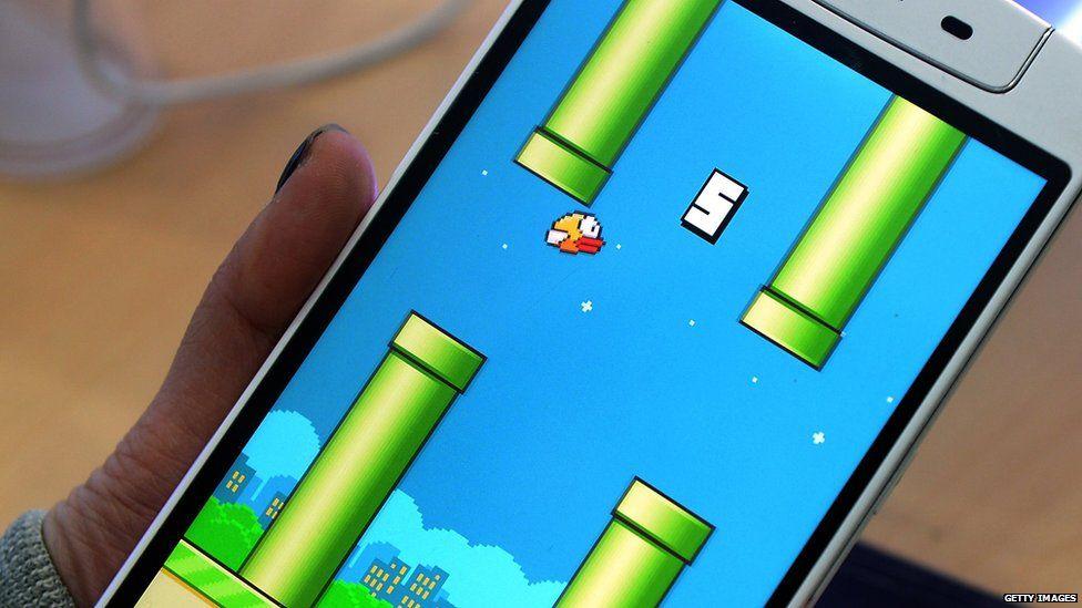 Someone plays Flappy Bird