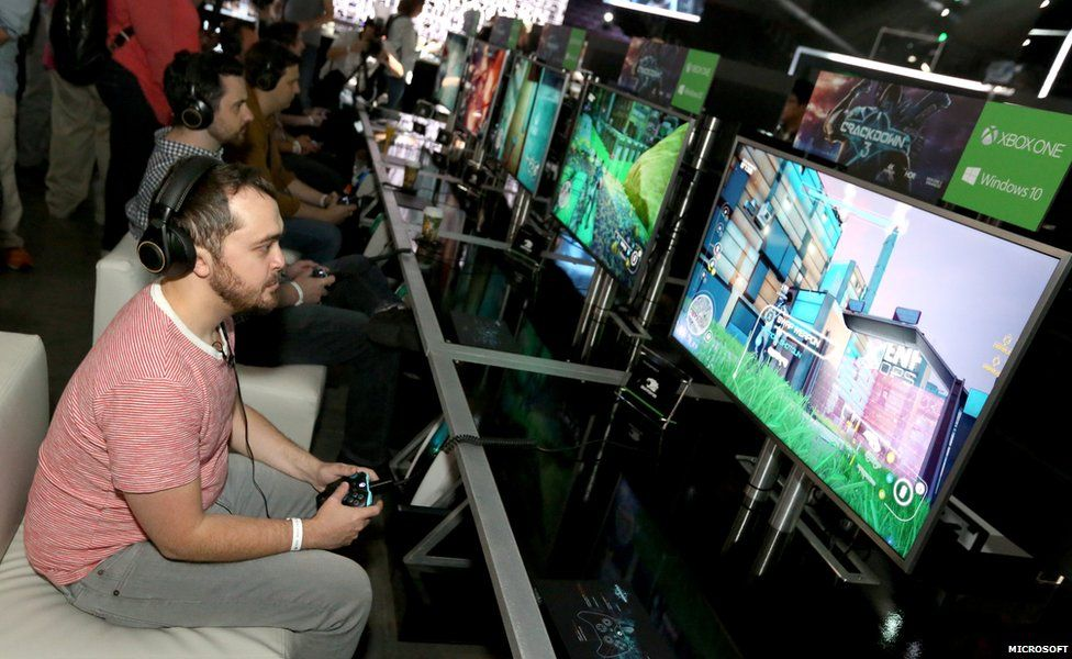A man playing on a console