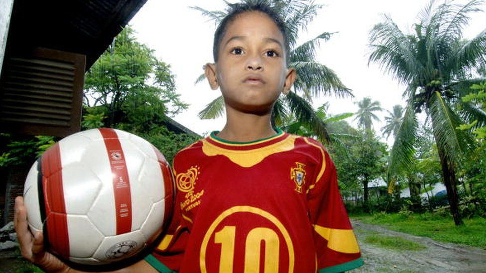 Martunis was 7 when he was pictured wearing a Portugal shirt after surviving the 2004 tsunami.