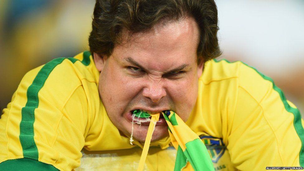 An emotional Brazil fan reacts after being defeated by Germany 7-1 during the 2014 FIFA World Cup Brazil Semi Final match between Brazil and Germany at Estadio Mineirao on July 8, 2014 in Belo Horizonte, Brazil.