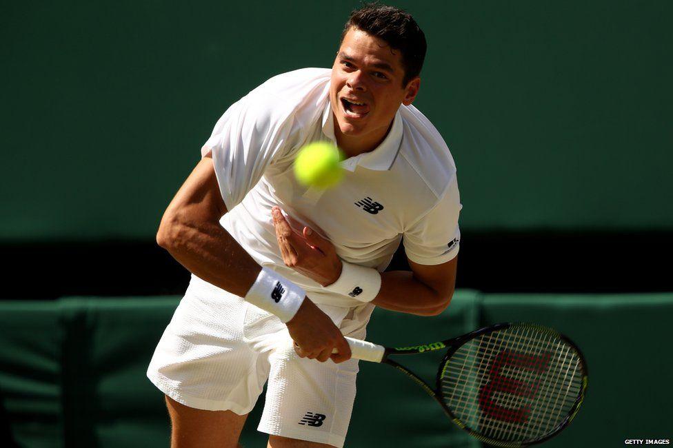 Milos Raonic serves against Andy Murray