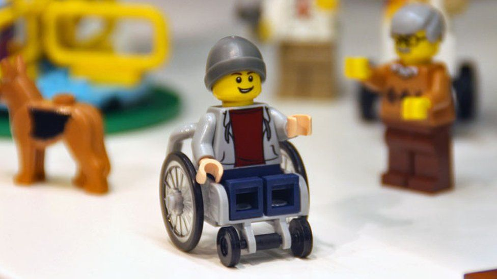 Young wheelchair using figurine