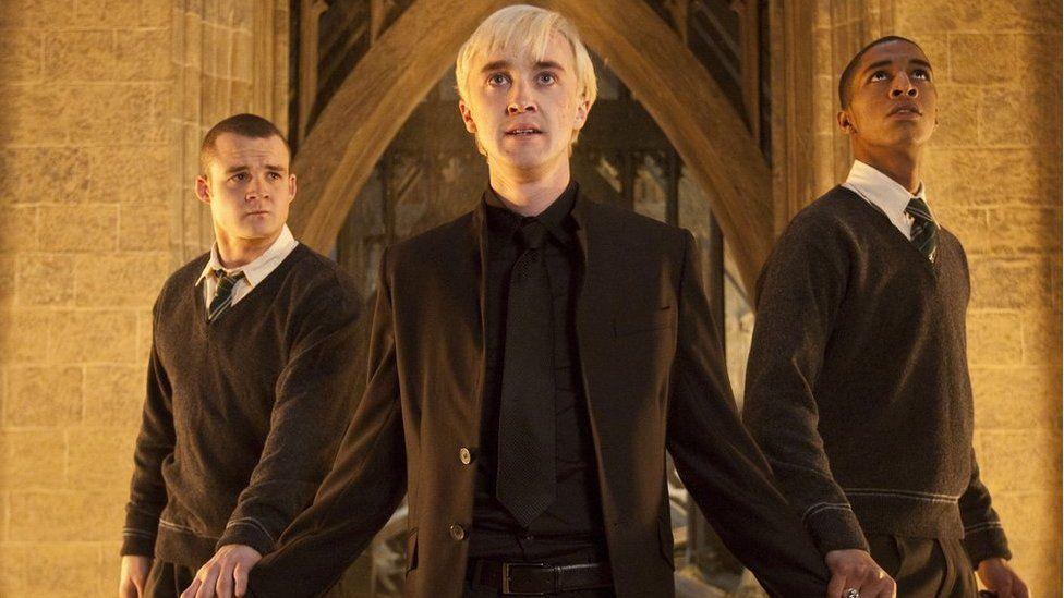 Josh Herdman as Gregory Goyle, Tom Felton as Draco Malfoy, Louis Cordice as Blaise Zabini