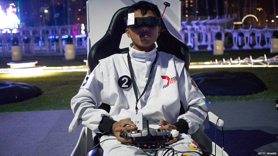 A pilot for Chinese team D1 sits in the pilot seat preparing to fly the team drone at the World Drone Prix drone racing championship in Dubai.