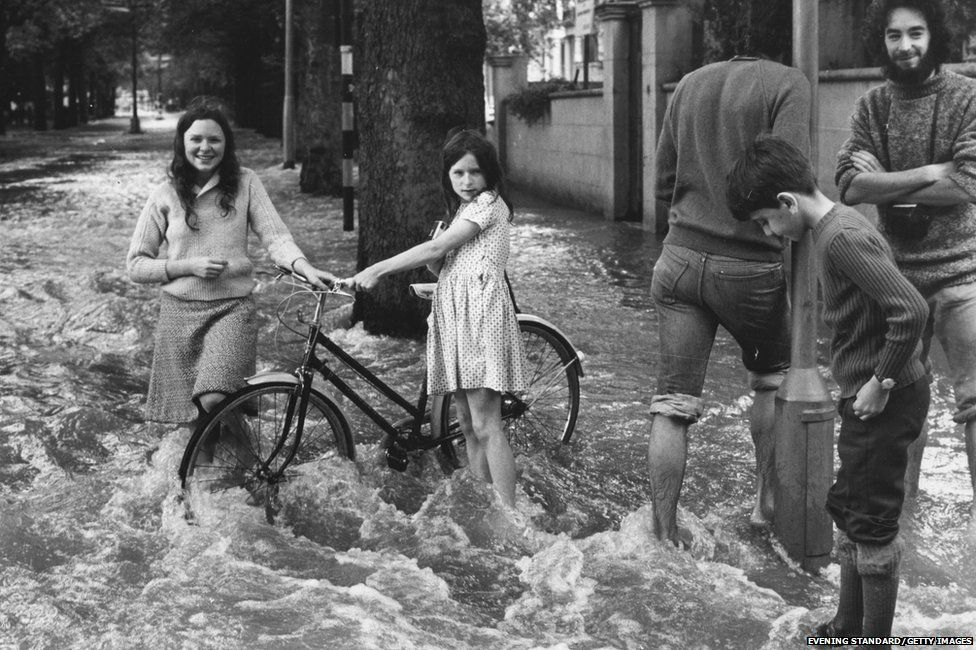 Flooding at the junction of Holland Park Gardens and Bayswater Road, London, after a water main burst