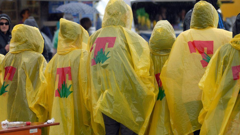 People shelter from the rain at T in the Park