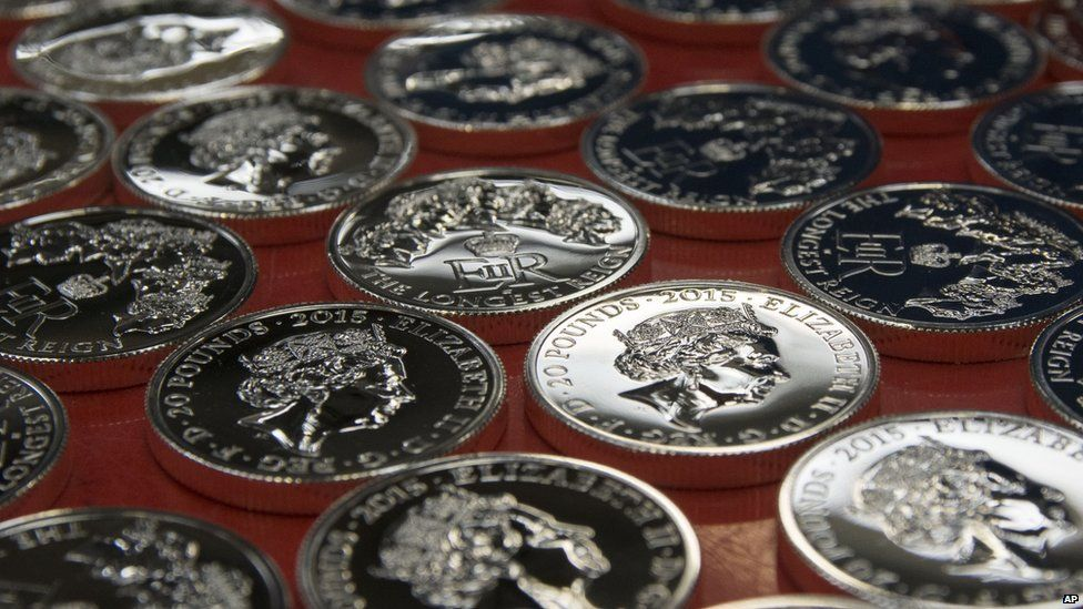 Queen Elizabeth's face on lot of coins
