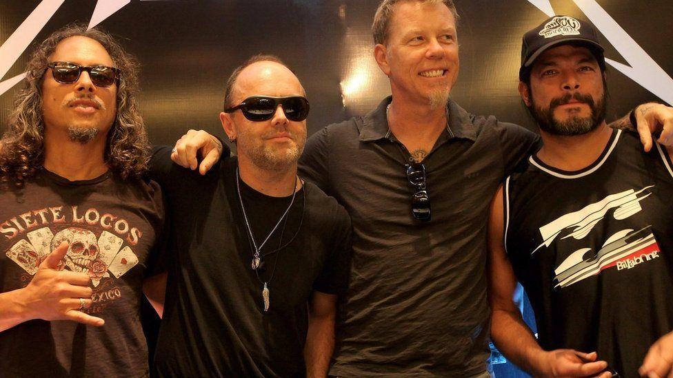 Metallica having a group hug