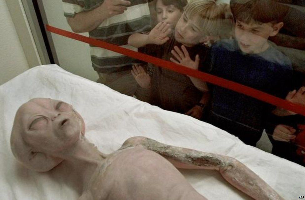 An alien model on display inside the International UFO Museum and Research Center in Roswell