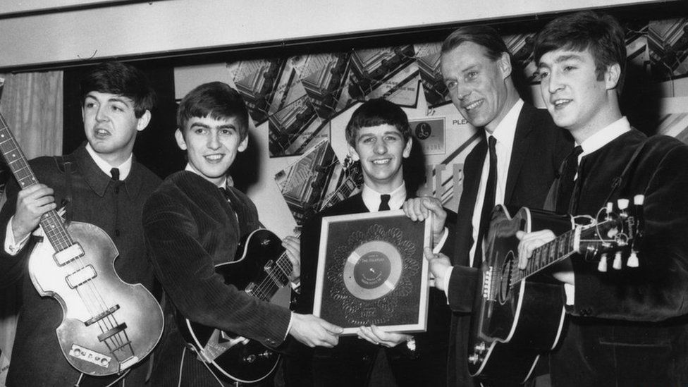 The Beatles holding their silver disc: Paul McCartney, George Harrison, Ringo Starr, George Martin and John Lennon