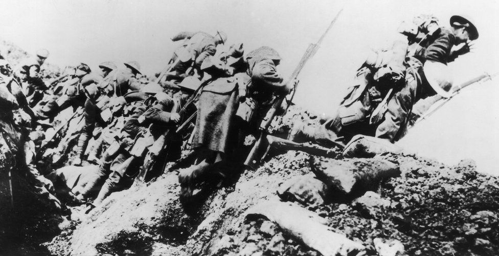 British troops climbing from their trench on the first day of 'The Big Push' on the Somme