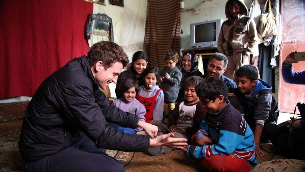 Greg meets children in Jordan