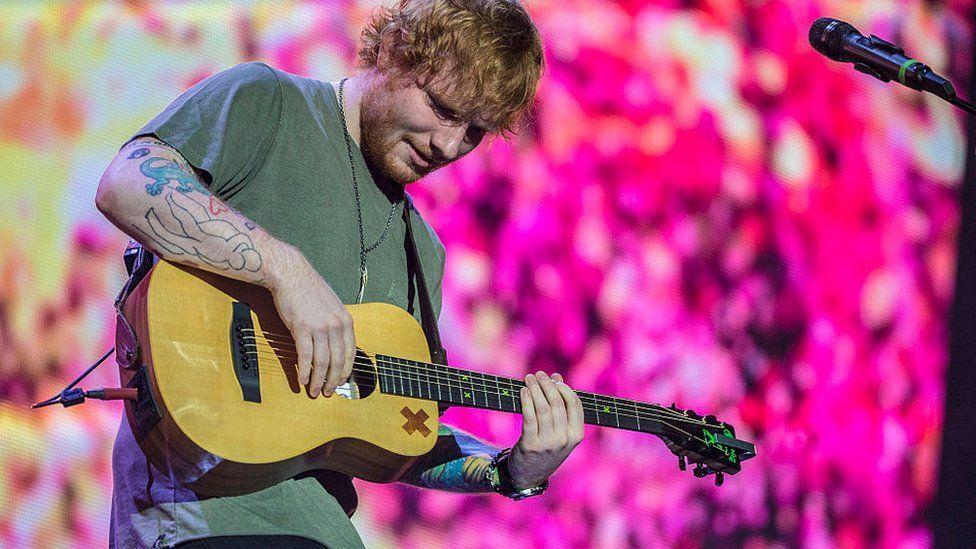 Ed Sheeran singing on stage