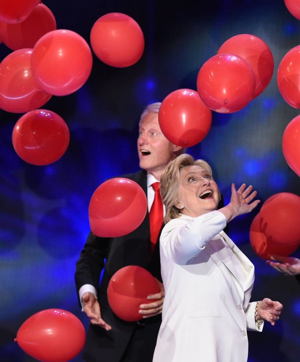 Balloons descend as Democratic presidential nominee Hillary Clinton and former US president Bill Clinton celebrate