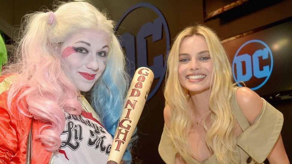 A fan and Margot Robbie