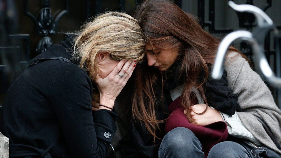 Two women crying together