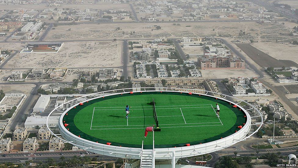 Federer plays Agassi on a helipad