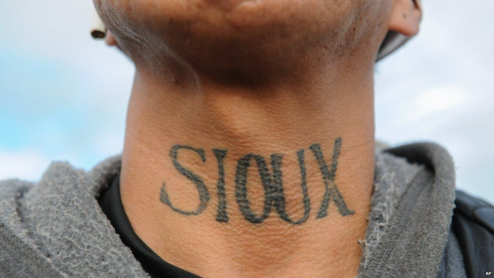 This is a photo of a Sioux Native American showing the tattoo on his neck in protest.
