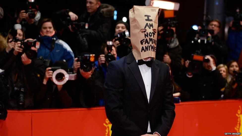 Shia LeBeouf wearing a paper bag on his head