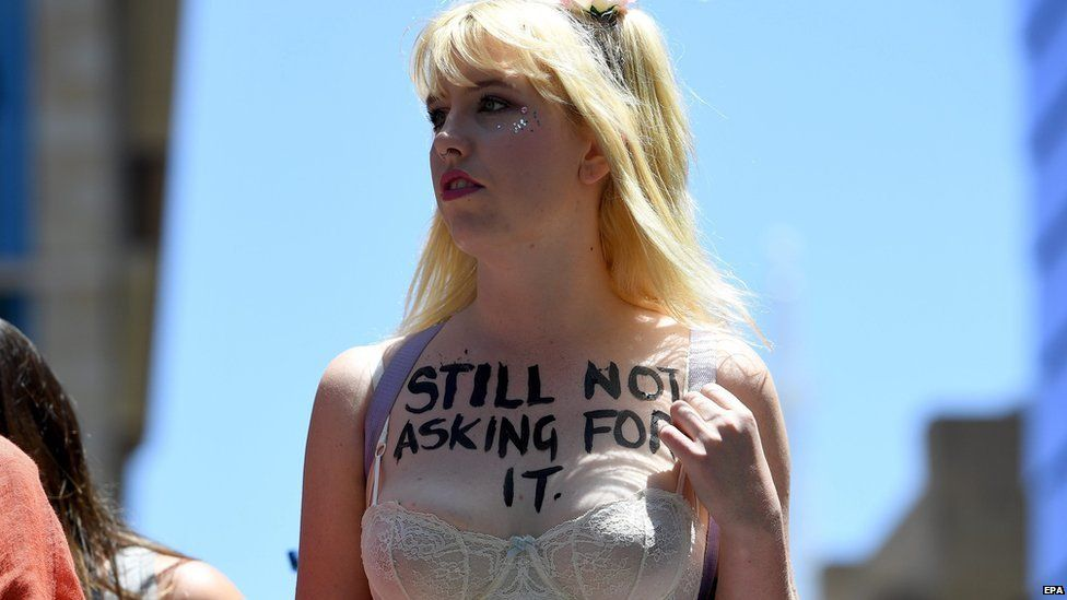 """Woman in underwear with """"Still not asking for it"""" written on her chest in Sydney - 21 January 2017"""