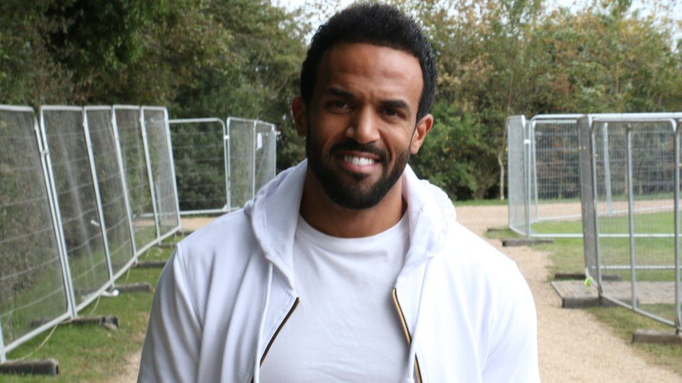 Craig David at Bestival. He's wearing all white.