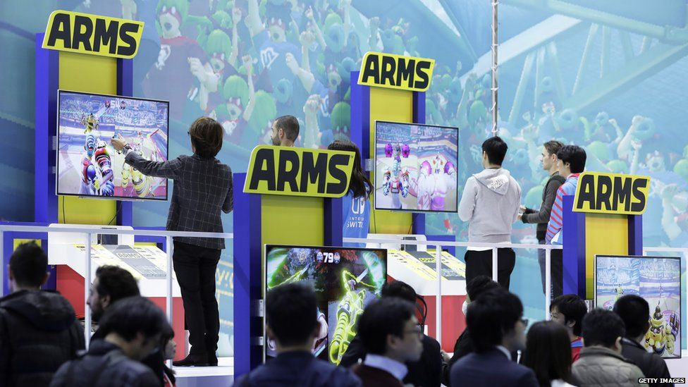People have a go at Arms at the Switch's launch event in Japan